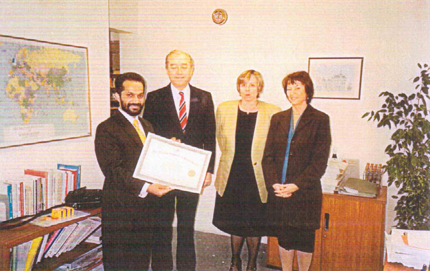 Receiving Post Graduate Diploma from the Director of the British Institute of Homeopathy, London