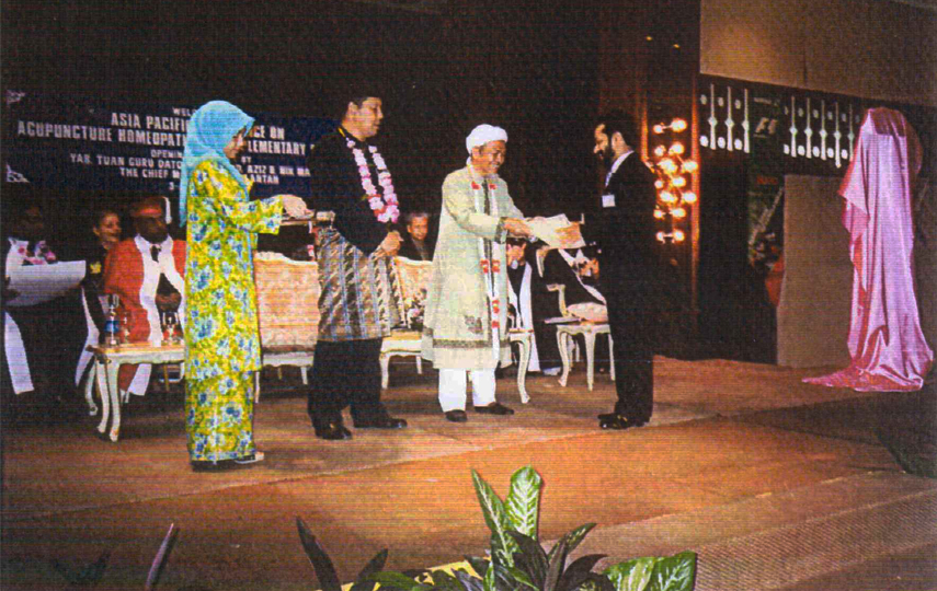 Receiving MFHOM from the Chief Minister, State of Kelantan, Malaysia