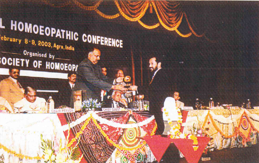 Being felicitated by the Health Minister, Uttar Pradesh, India at the 12th International Homeopathic Conference